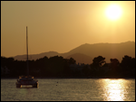 Sail boat in the sunset of Alcudia